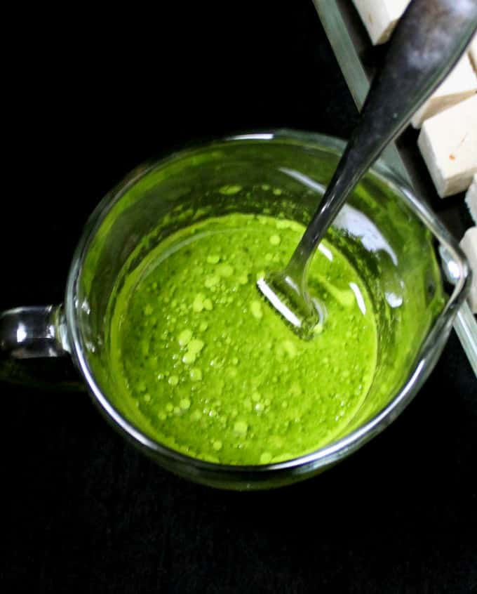 Green cilantro and green chili pepper marinade for tofu cubes