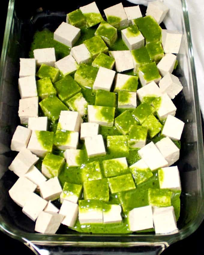 Tofu cubes with marinade poured over them