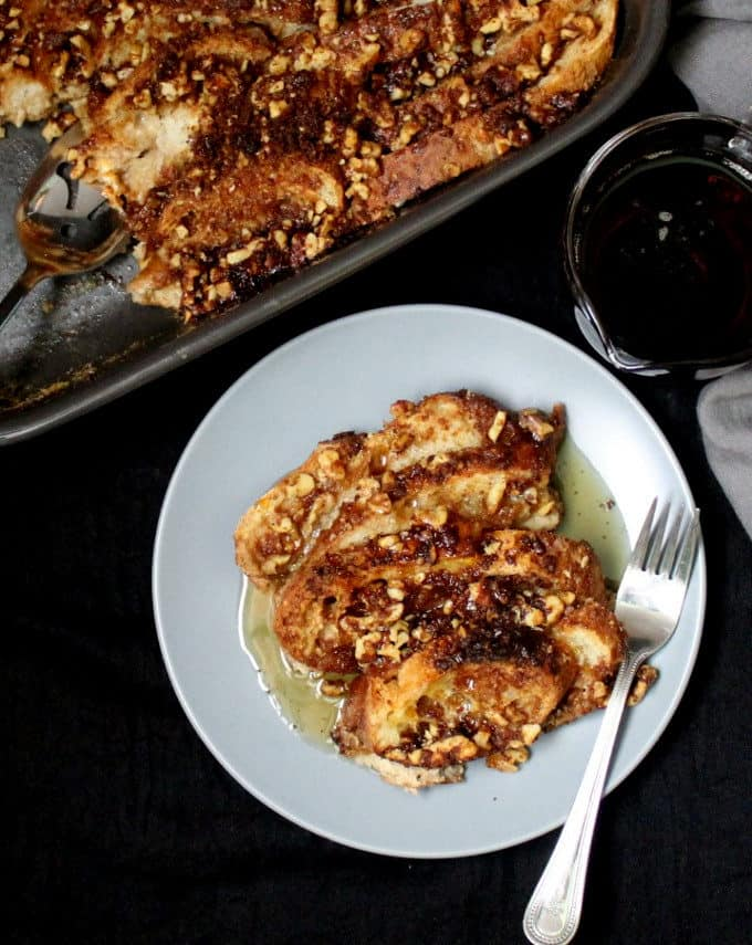 Vegan French Toast Casserole with a crunchy candied walnut topping and a creamy, gooey custard of cashew milk, cinnamon and nutmeg.