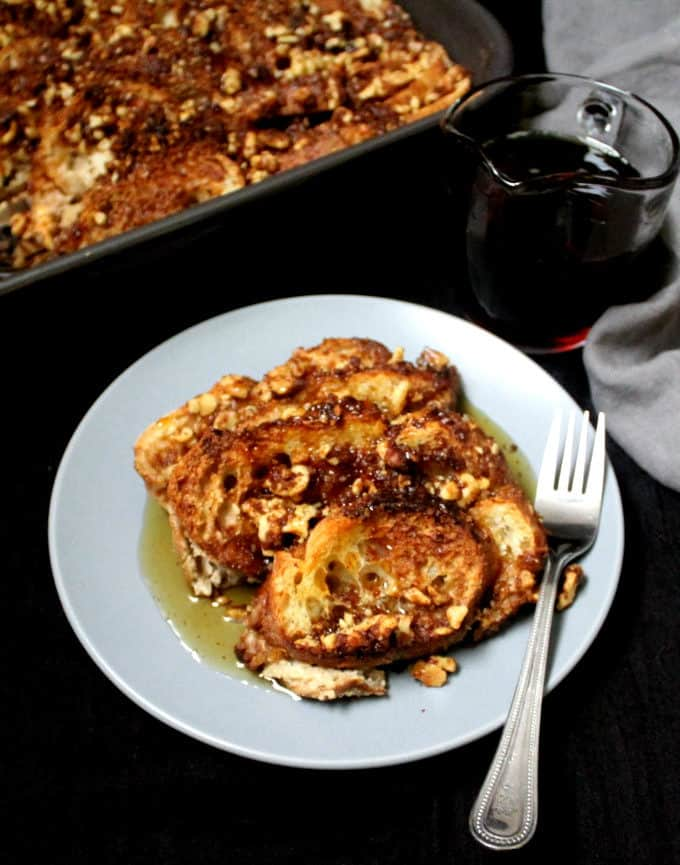 A front view of a piece of French toast with the casserole in the background