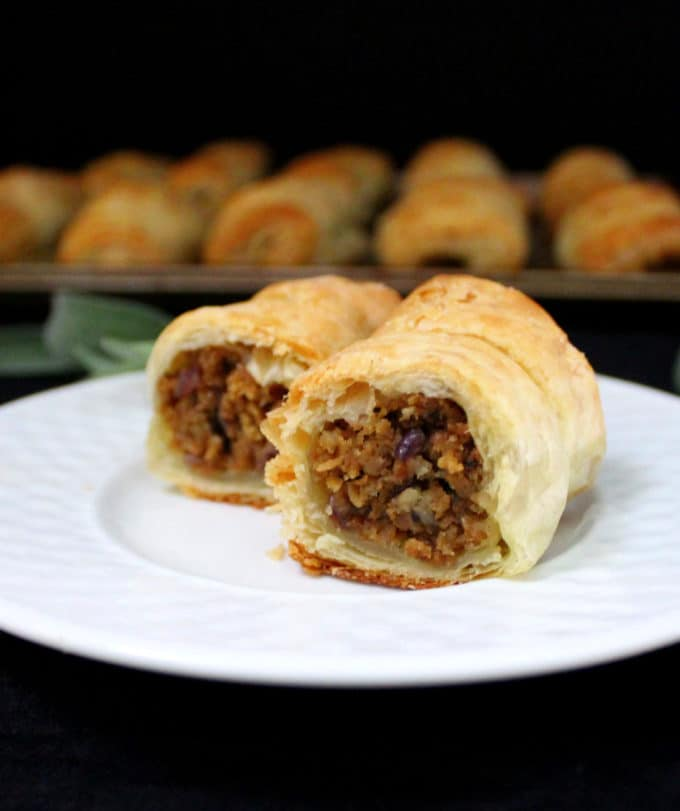 Meatless sausage rolls on a white plate