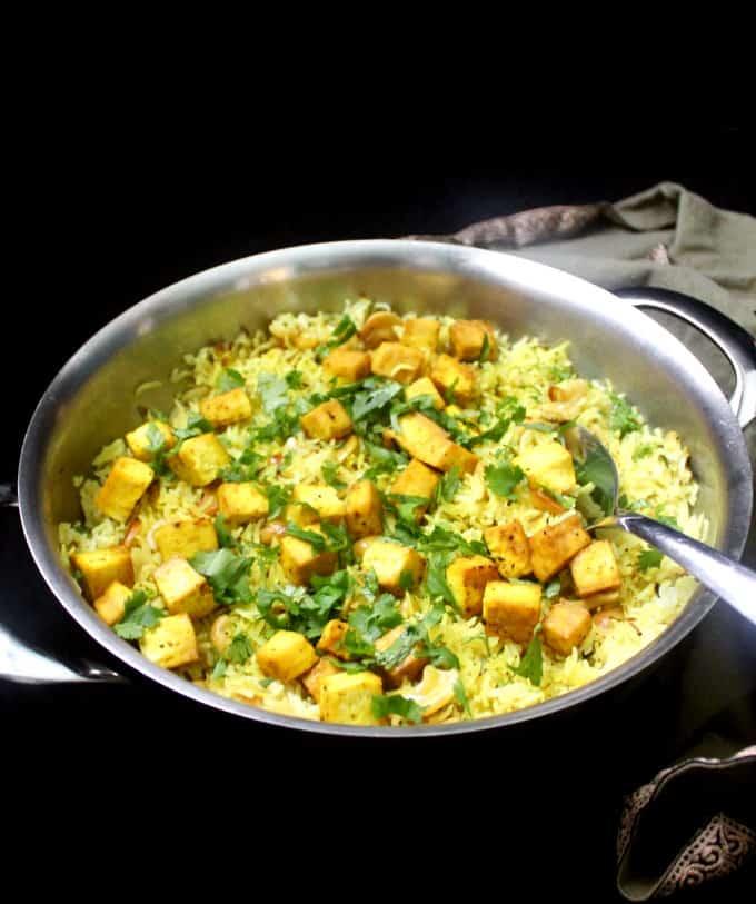 Front shot of a steel pot of lemon garlic rice