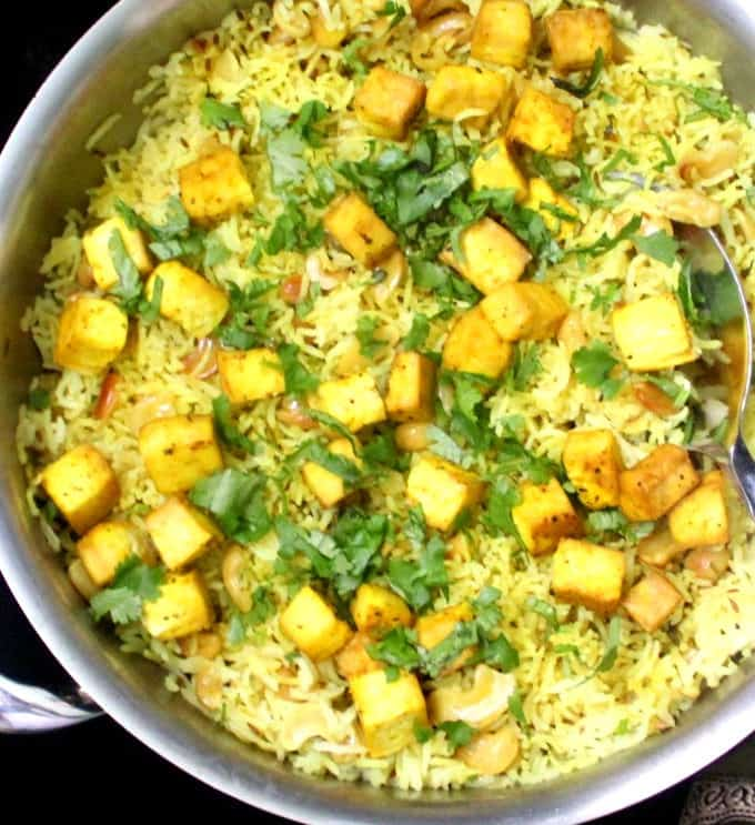 Lemon Garlic Rice in a steel pan garnished with cilantro and with tofu cubes