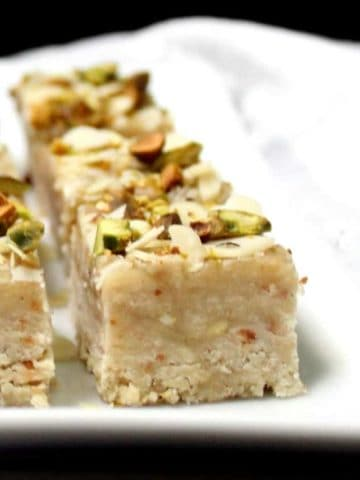 Vegan Barfi with nuts on a white plate