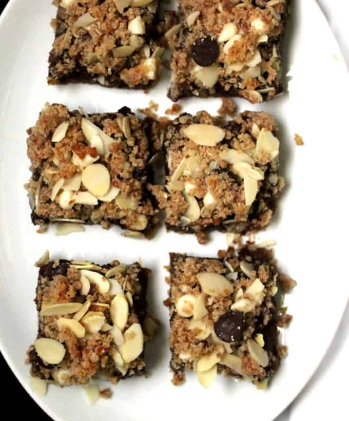 Photo of rows of vegan chocolate and nut cookie bars, gluten-free