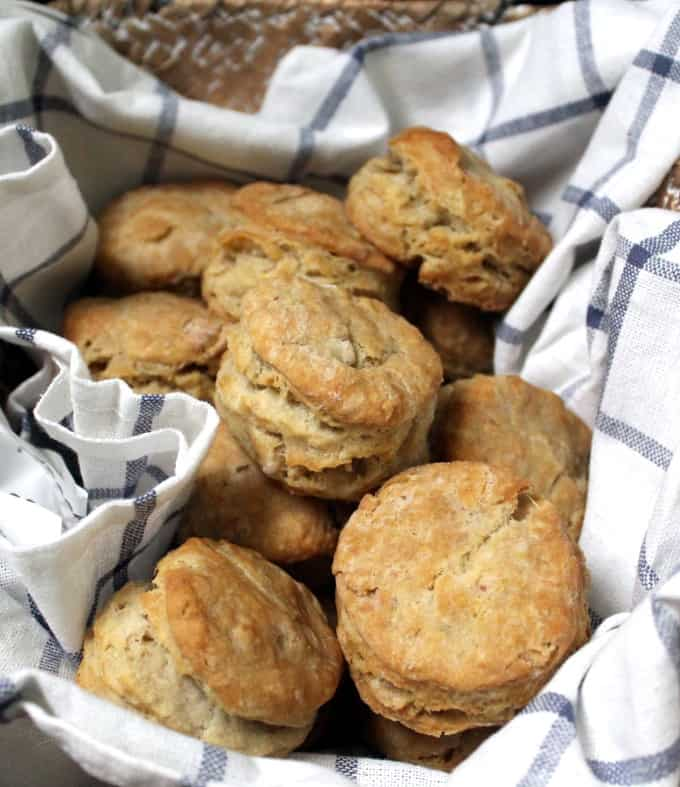 Overhead shot of a basket filled with golden, crunchy, round vegan biscuits
