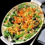 A top shot of a vegan green bean casserole in a yellow and white old-fashioned casserole dish