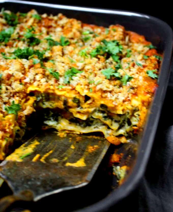 Closeup shot of the layers of vegan pumpkin lasagna in a baking dish