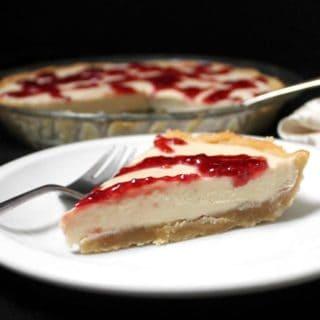 vegan white chocolate silk pie with raspberry drizzle and shortbread crust, glutenfree