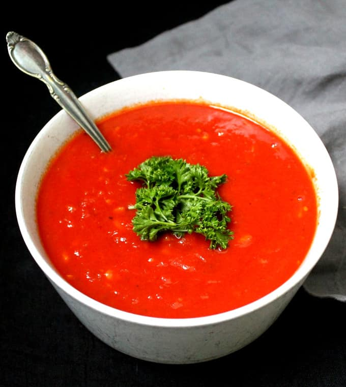 A bright red marinara sauce made with San Marzano tomatoes and parsley for garnish
