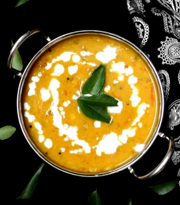 Top shot of a bowl of creamy red lentil dhal or red lentil dahl with coconut milk