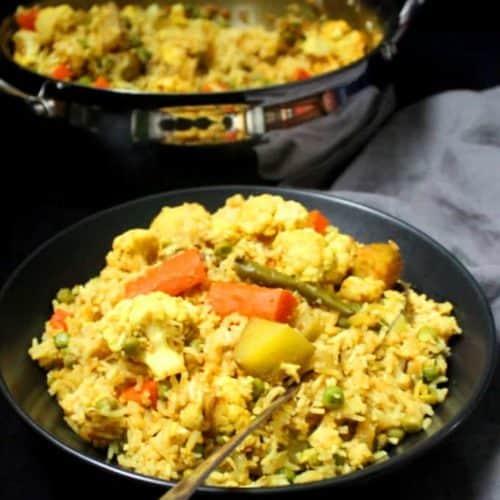 Vegetable Tehri or Tahiri, a rice pulao with veggies like cauliflower, carrots, potatoes and green peas