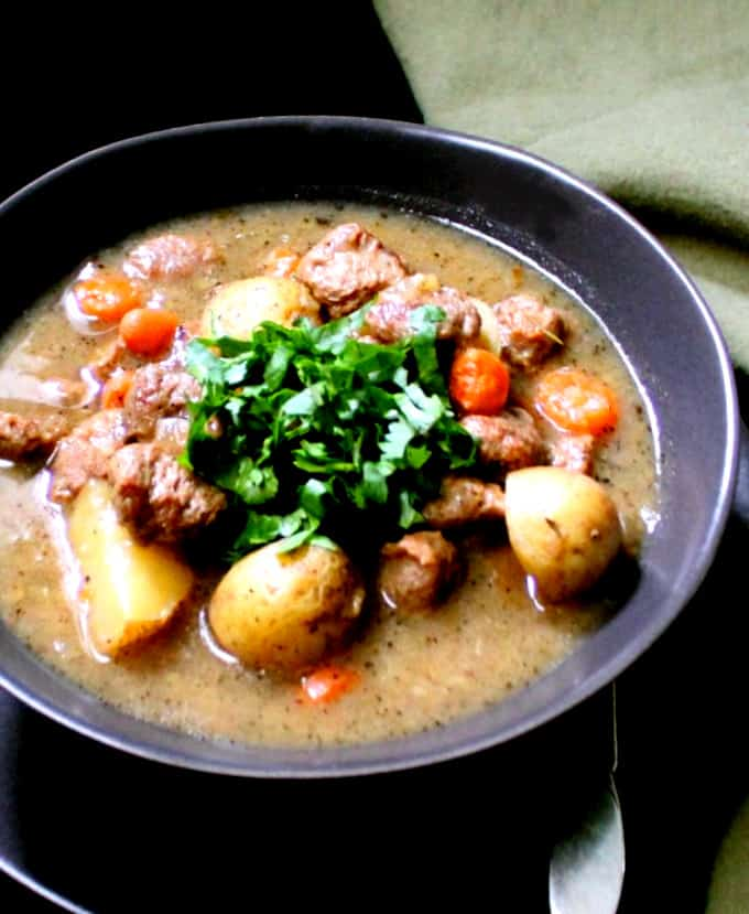 A big, comforting bowl of vegan stew with faux beef chunks, carrots, potatoes and celery