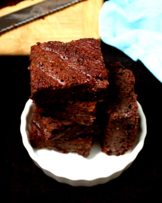 Vegan gluten free brownies in a white ramekin