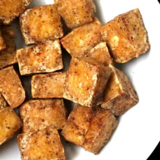 Close up shot of cubes of air fried tofu
