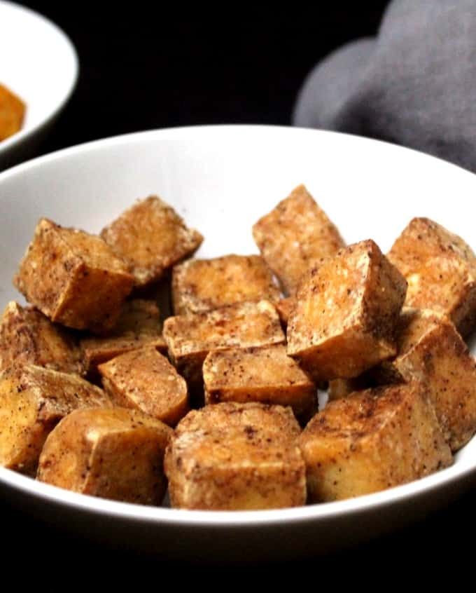 Air-fried tofu cubes in a white ceramic bowl