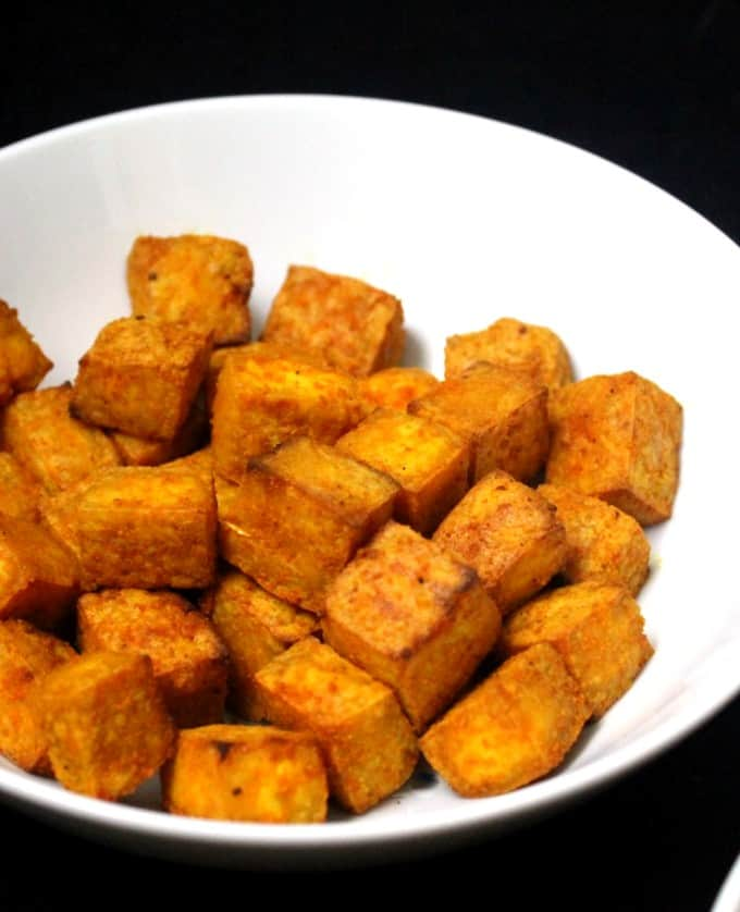 Indian air fryer tofu with turmeric in a white ceramic bowl