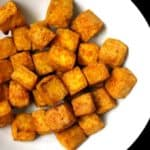 Indian style air fryer tofu cubes in a white bowl