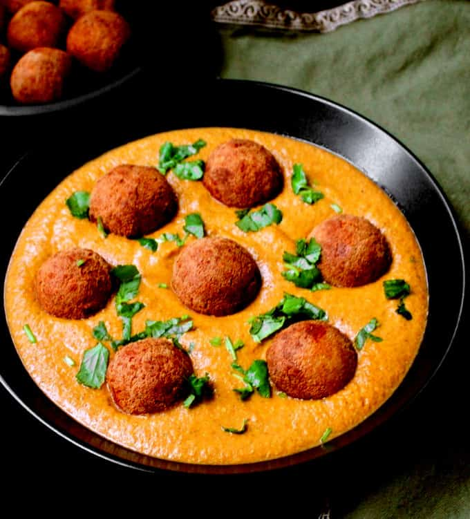 Vegan Malai Kofta Curry, Indian style dumplings in a creamy spiced tomato onion sauce