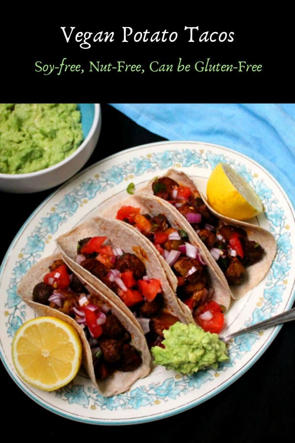 Vegan Potato Tacos on a blue and white platter with guacamole and salsa