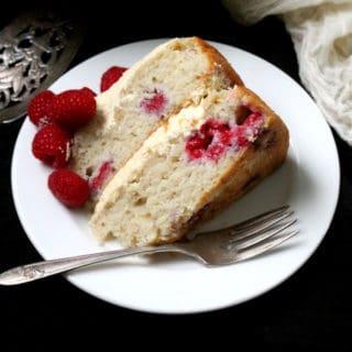 Front shot of a slice of vegan white chocolate raspberry cake