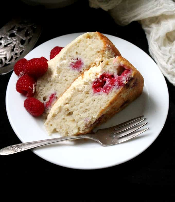 Front shot of a slice of vegan white chocolate raspberry cake
