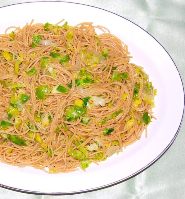 A platter with vegan spaghetti with brussels sprouts.