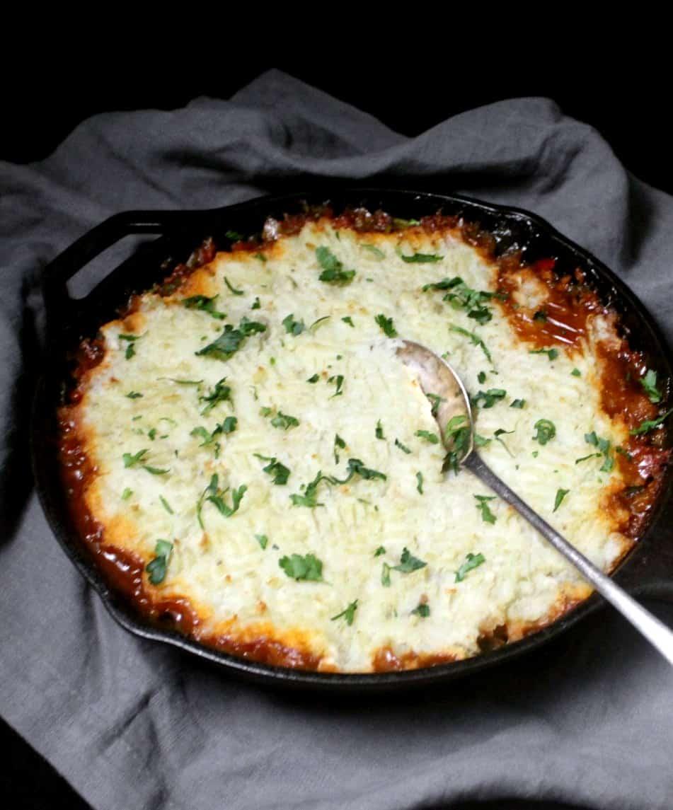 A front shot of vegan breakfast shepherd's pie in a black cast iron griddle