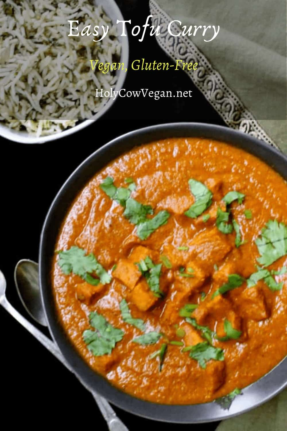Tofu Curry, a quick and easy weeknight dish. Sere with rice or with a flatbread like naan, or just any crusty bread. Seen in the photo with a cilantro garnish, a bowl of rice and a green napkin.