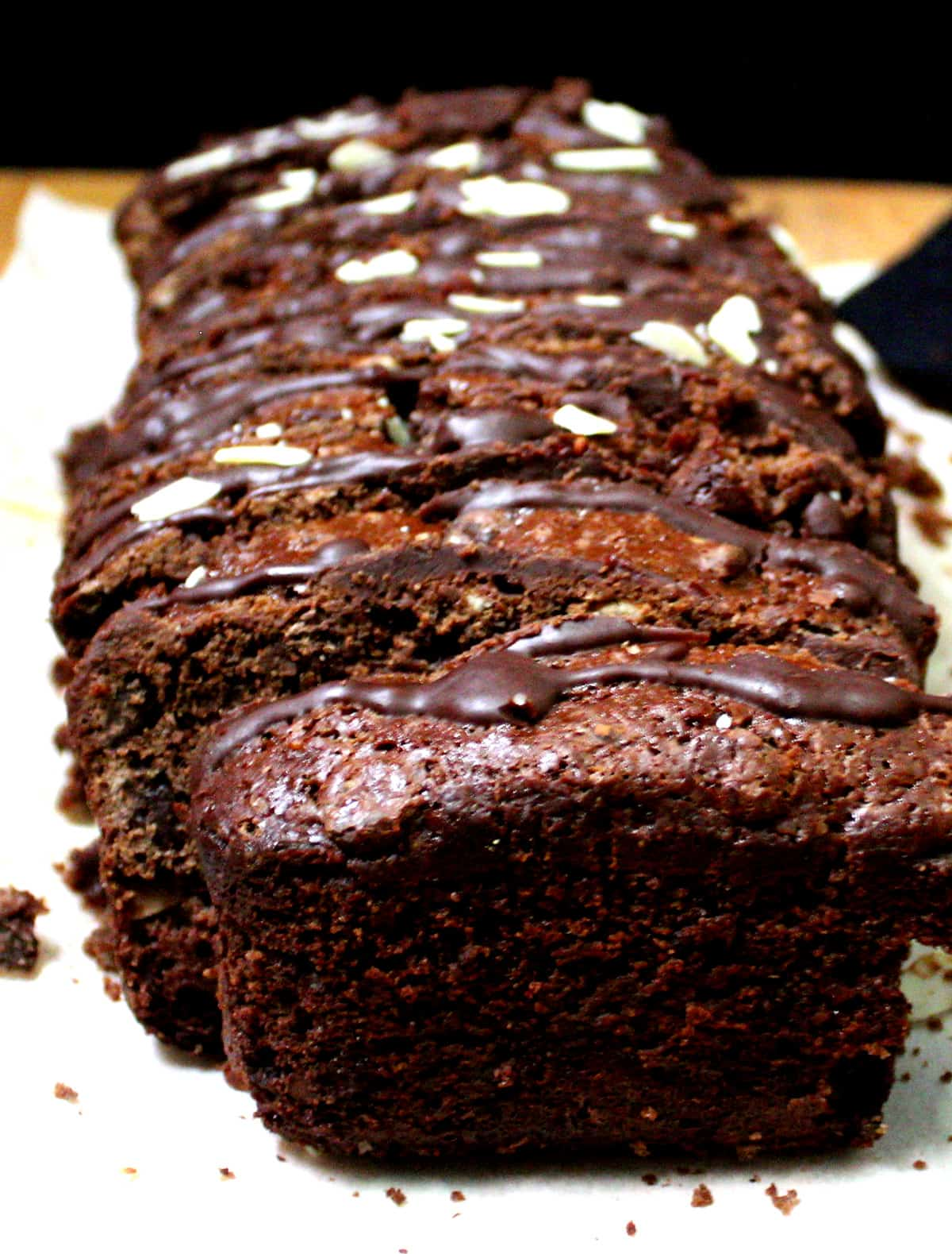 Front shot of sliced vegan chocolate bread with chocolate glaze.