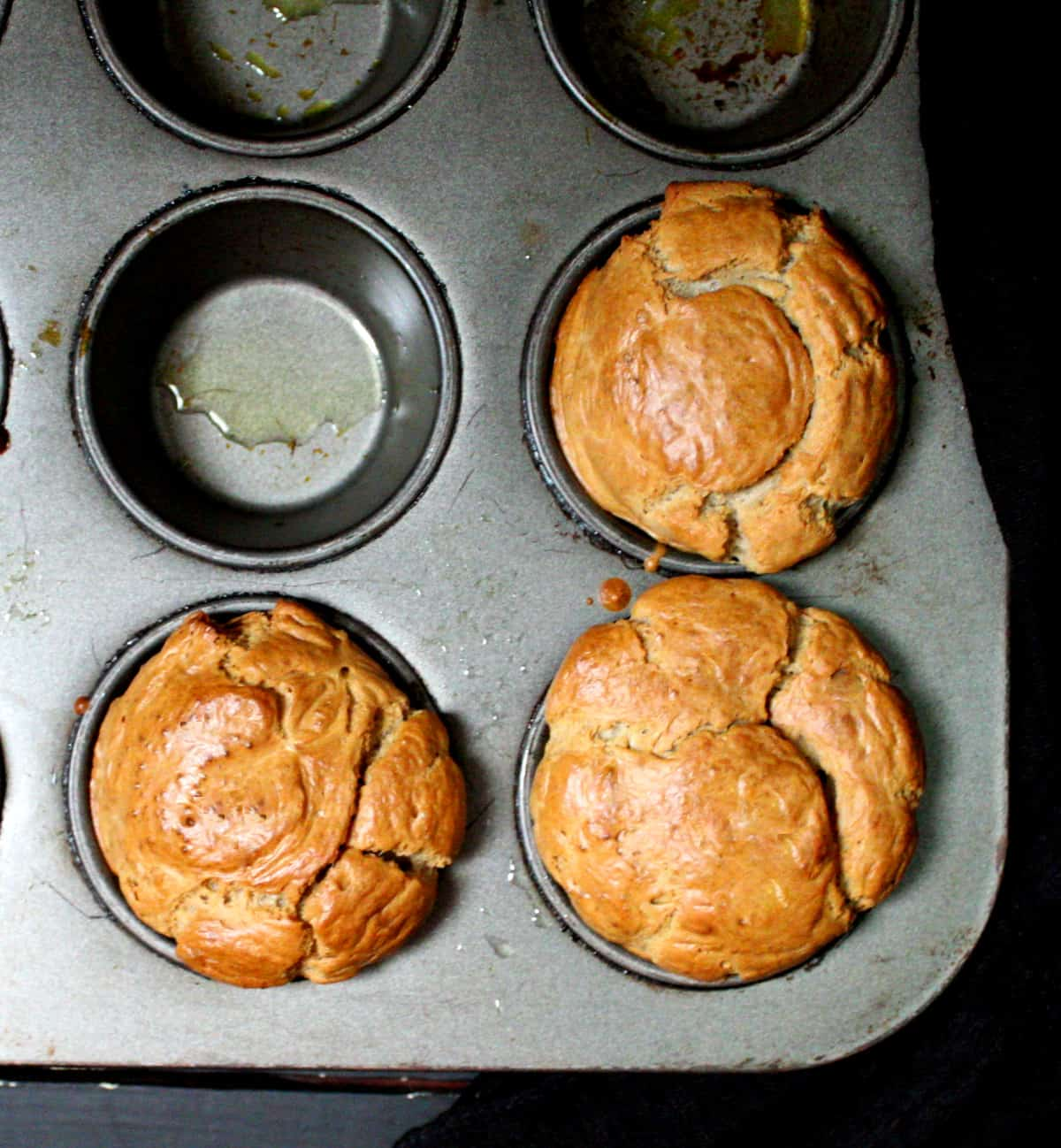 Top shot of three popovers in the muffin tin.