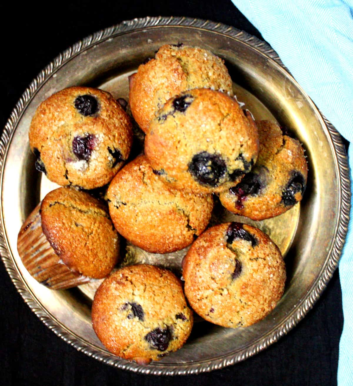 Overhead shot of a silver serving plate with sourdough muffins with blueberries.