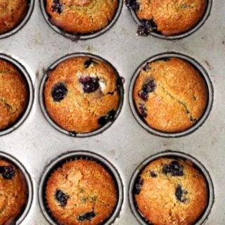 Vegan Blueberry Sourdough Muffins in a muffin pan