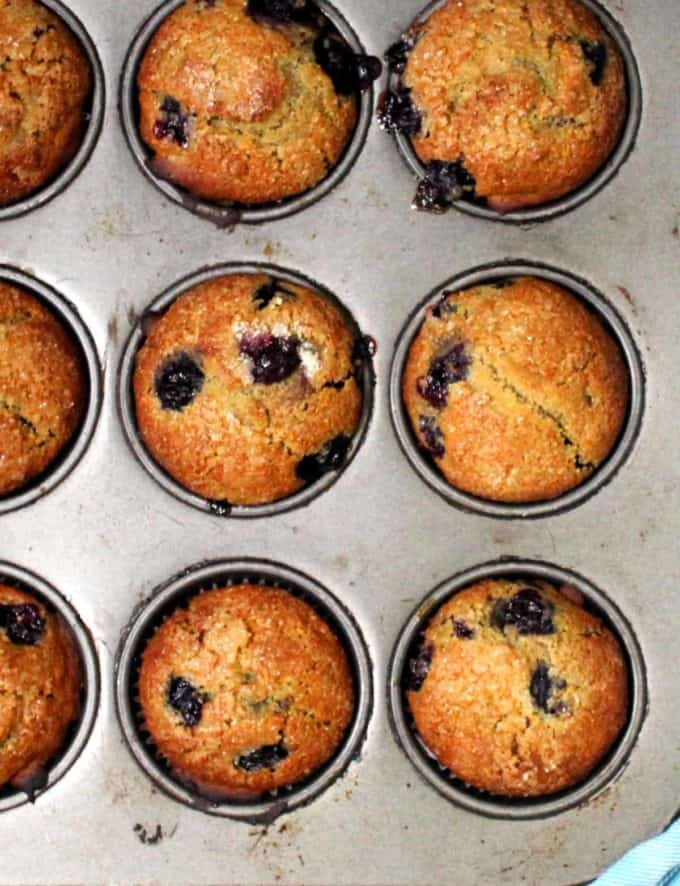 Overhead shot of six vegan blueberry sourdough muffins.