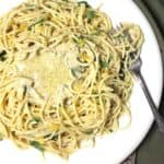 A close up of vegan lemon pasta with basil, lemon zest and a creamy olive-oil-lemon sauce