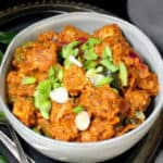 Here's a garlicky, spicy, mindblowingly delicious Indian dish that'll have your tastebuds doing a happy dance: Tofu Paneer 65. Crispy bits of air-fried or baked tofu are dunked into an appetizing, tasty curry of yogurt and mixed spices. You can eat it for a snack or scoop it up with an Indian flatbread like naan or roti