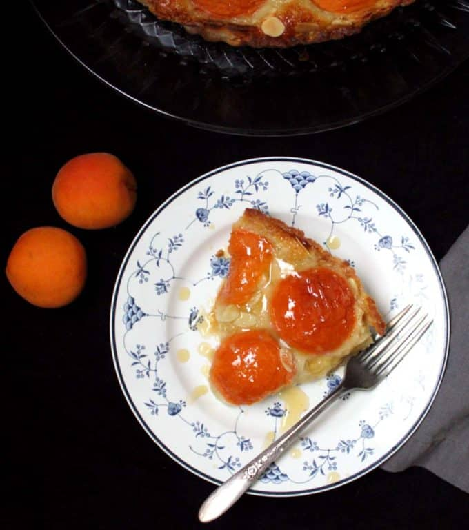 Overhead closeup of a vegan apricot frangipane tart with a silver fork.
