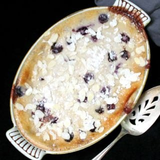 An overhead shot of vegan cherry clafoutis made with tofu with a silver cake server