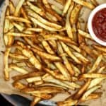 These Air Fryer French Fries are perfection itself. They turn out all crispy and delicious in an air fryer with a minimal quantity of oil. If you want an even healthier, no-oil option, I've got you covered as well. #frenchfries, #airfryer, #lowfat | HolyCowVegan.net