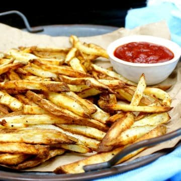 These Air Fryer French Fries are perfection itself. They turn out all crispy and delicious in an air fryer with a minimal quantity of oil. If you want an even healthier, no-oil option, I've got you covered as well. #frenchfries, #airfryer, #potatoes | HolyCowVegan.net
