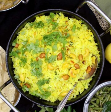 Although south Indian in origin, this fragrant lemon rice can accompany nearly any meal anywhere in the world. Long grains of basmati rice are tempered with mustard seeds, lentils, chili peppers and nuts, and lots of tangy lemon juice ties all these vibrant flavors together. A vegan, soy-free, gluten-free recipe, can be nut-free. #vegan, #rice, #southIndian, #lemon