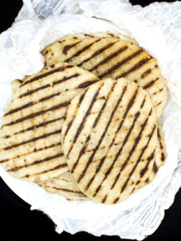 Vegan Gluten Free Naan: Learn how to make the best gf Naan to dunk into your favorite vegan Indian curries and sauces. You can make this with or without yeast. Soy-free, nut-free recipe. #vegan, #glutenfree, #naan, #bread | HolyCowVegan.net