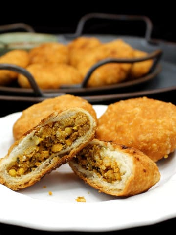 Kachori is a beloved savory Indian food, often sold on the streets. It has a crispy, flaky jacket of wheat wrapping a savory, spicy filling of moong dal. This homemade version make the perfect snack for a cold evening with a cup of hot tea. A vegan, soy-free and nut-free recipe.