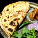"Mooli paratha image with text inlay that says ""mooli paratha, radish stuffed flatbread."