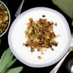 Make this creamy vegan Cauliflower soup with a crunchy and herby breadcrumb topping to satisfy that urge for something warm and comforting in your belly as the leaves turn brown and the weather begins to bite. A soy-free recipe, can be nut-free and gluten-free. #vegan, #soup, #cauliflower, #glutenfree | HolyCowVegan.net