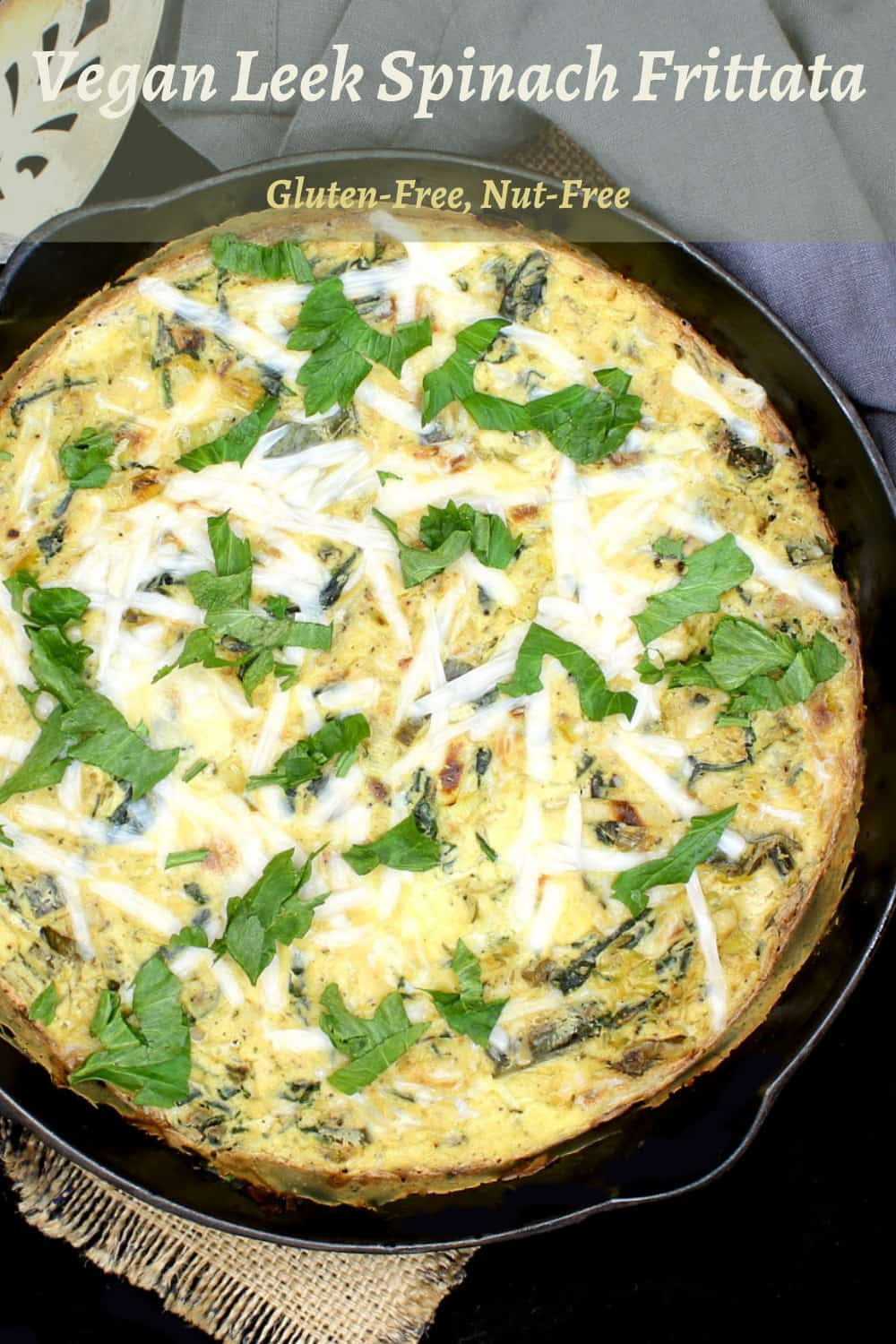 Here's a simple vegan Leek and Spinach Frittata with fresh leeks and spinach wrapped in a savory, creamy, herby custard of tofu and vegan cheese. It's a delicious, protein-packed meal you can devour any time of day. A nut-free and gluten-free recipe. #vegan, #frittata, #eggless, #veggies | HolyCowVegan.net
