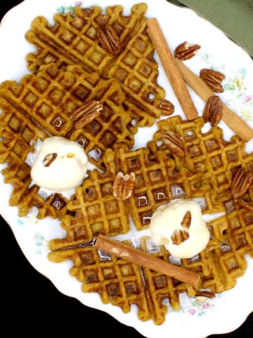 These tasty Vegan Sourdough Pumpkin Spice Waffles are infused with the seasonal flavor of pumpkin and the warmth of pumpkin pie spices like cinnamon, cloves and nutmeg. A wholegrain, soy-free and nut-free recipe, can be made with sourdough discard. #vegan, #pumpkinspice, #waffles, #sourdough | HolyCowVegan.net