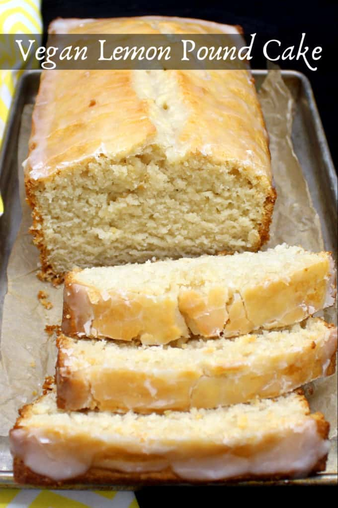 A sliced vegan lemon pound cake on butter paper in a metal baking tray