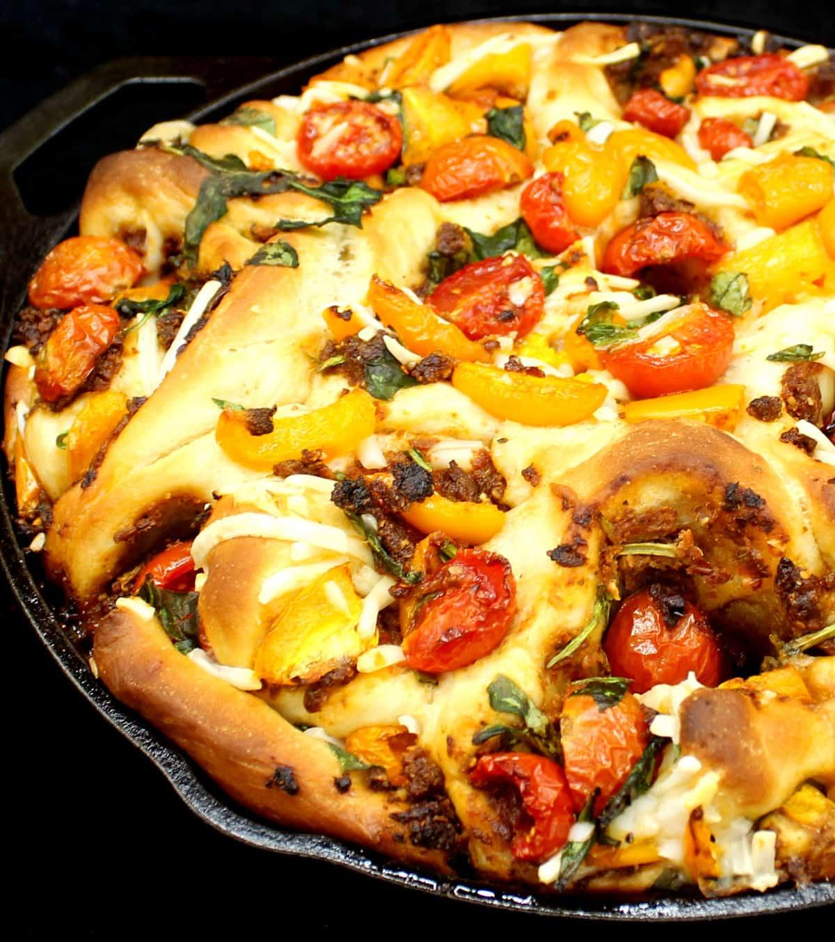 Vegan Pizza Rolls in skillet with lots of veggies