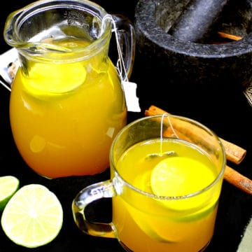 Ginger turmeric tea, homemade, in a cup and jar